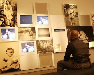 A Marine watches videos during a recent tour of the National Prisoner of War Museum in in Andersonville, Ga., recently.