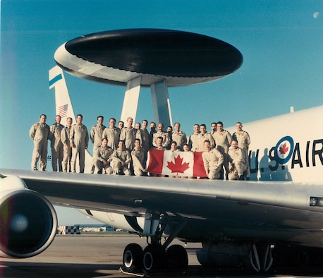 Members of the Canadian Detachment stand aboard the E-3 Sentry AWACS.
