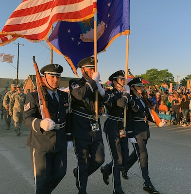 The 433rd Airlift Wing's Honor Guard leads the 433rd Airlift Wing and 960th Cyberspace Wing walkers and float on Dolorosa Street in downtown San Antonio during the 71st annual Fiesta Flambeau Parade April 27. More than 750,000 spectators lined the 2.6-mile-long route see more than 200 floats and marching bands perform in the grand finale of Fiesta Week.