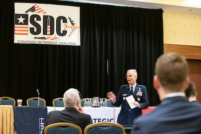 A military general speaks before an audience.