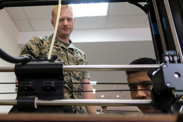 U.S. Marines with Special Purpose Marine Air-Ground Task Force-Crisis Response-Africa observe a 3D printer during an Additive Manufacturing course at Morón Air Base, Spain, June 27, 2018. Marine Corps Systems Command's Advanced Manufacturing Operations Cell will display additive manufacturing capabilities during the 54th annual Sea-Air-Space Exposition, held May 6–8 at the Gaylord Convention Center in National Harbor, Maryland. (U.S. photo by (U.S. Marine Corps photo by Staff Sgt. Britni M. Garcia Green)
