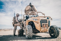 A Marine with 11th Marine Expeditionary Unit programs a counter-unmanned aircraft system on a Light Marine Air Defense Integrated System during a predeployment training exercise at Marine Corps Air Ground Combat Center, Twentynine Palms, California, Nov. 13, 2018. The LMADIS and other innovations will be on display during the 54th annual Sea-Air-Space Exposition, held May 6–8 at the Gaylord Convention Center in National Harbor, Maryland. (U.S. Marine Corps photo by Lance Cpl. Dalton S. Swanbeck)