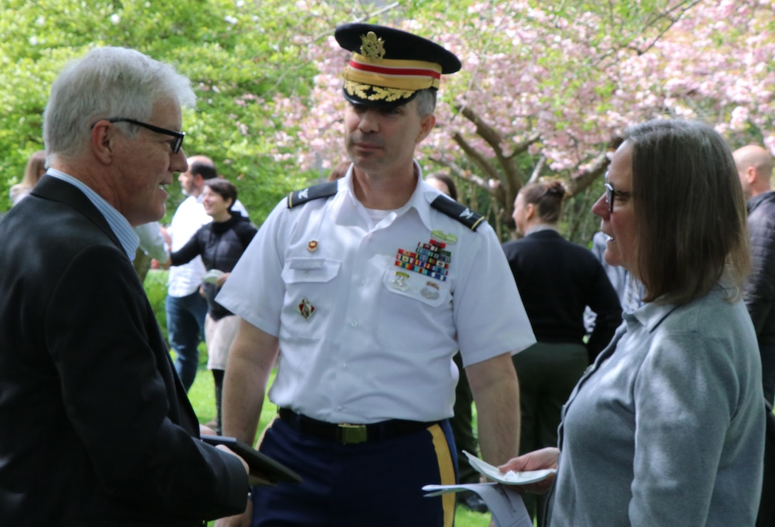 Discover Your Northwest Executive Director Jim Adams and board member Christy McDanold, talk with Seattle District Commander Col. Mark Geraldi at the locks.