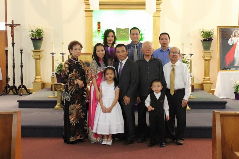 Lt. Col. Asan Bui (center), a flight commander with the 920th Rescue Wing, poses with his family at their local church. Bui, a devout Catholic, said his community and faith provided him with positive outlets growing up, to include piano lessons. The 920th RQW conducts combat-search-and rescue missions at land and sea. (Courtesy photo)