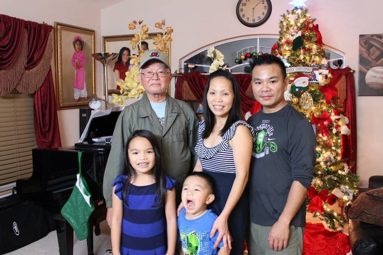 Reserve Citizen Airman, Lt. Col. Asan Bui, poses for a holiday photo with his wife, children and father. Bui currently serves as commander of the 920th Communication Flight, an Air Force Reserve unit located at Patrick Air Force Base, Florida. (Courtesy photo)