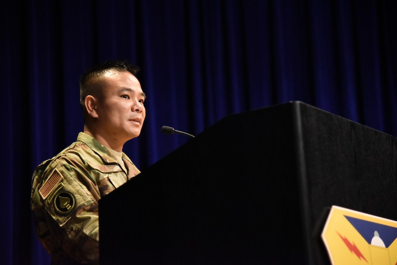 Lt. Col. Asan Bui, addresses his family and friends during his assumption of command ceremony at Patrick Air Force Base, Florida, on July 14, 2018. The event recognized the transition of power as Bui became the 920th Communications Flight commander.  (U.S. Air Force photo by Senior Airman Brandon Kalloo Sanes)