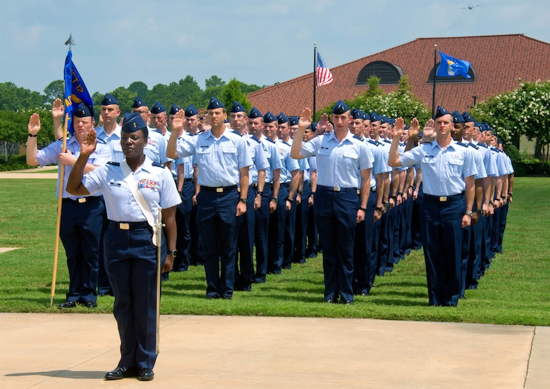 Officer Training School cadets in OTS class 16-07 take the oath of office during their graduation parade at Maxwell Air Force Base, Alabama on June 17, 2016. In April 2019, Maxwell AFB announced two beta courses, called Officer Training School-Accelerated Commissioning Program, that will shorten OTS from 40 training days to 14 training days for selected senior NCOs. (US Air Force photo by Melanie Rodgers Cox/Released)