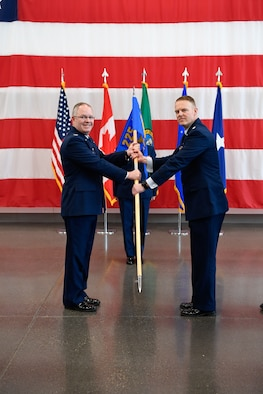 Col. Scott Humphrey presides over the 225th Air Defense Squadron Change of Command ceremony where Col. Brett Bosselmann relinguishes command to Lt. Col. Brian Bergren at the Pierce County Readiness Center, April 10, 2019.