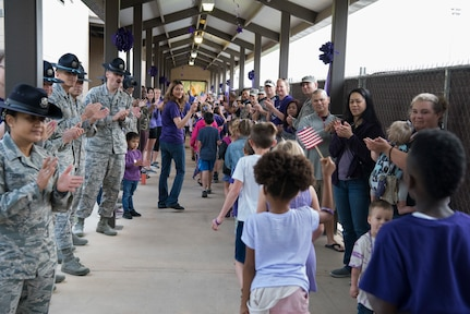 Students at Lackland Independent School District march in the PurpleUp! Parade April 12, 2019, at Joint Base San Antonio-Lackland, Texas.