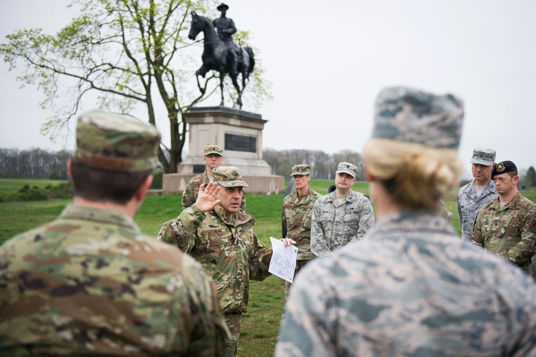 Army Col. Phillip Cuccia, U.S. Army War College academic engagement director, highlights opening actions of the Battle of Gettysburg to U.S. Air Force field grade officers at Gettysburg National Military Park, Pa., April 18, 2019. The officers took a tour of the park during the 2019 Air Force District of Washington Squadron Commander and Spouse Orientation Course to learn about leadership principles from the past, and how they relate to the present. (U.S. Air Force photo by Master Sgt. Michael B. Keller)