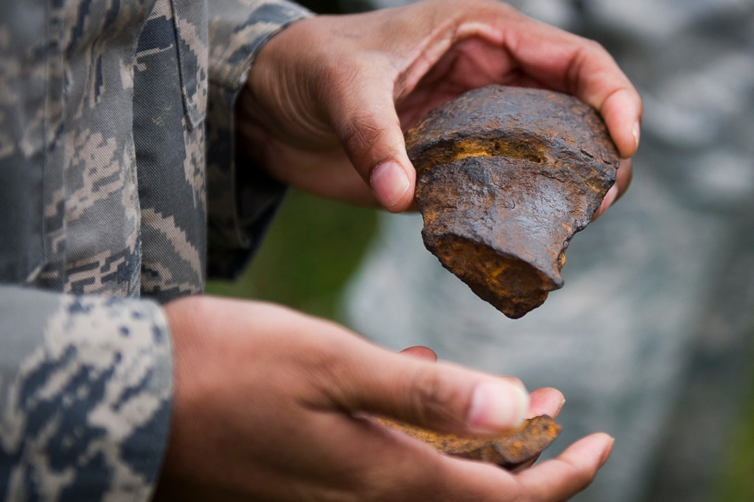 Air Force Master Sgt. Amaani Lyle inspects the remains of Civil War-era ammunition at Gettysburg National Military Park, Pa., April 18, 2019. (U.S. Air Force photo by Master Sgt. Michael B. Keller)