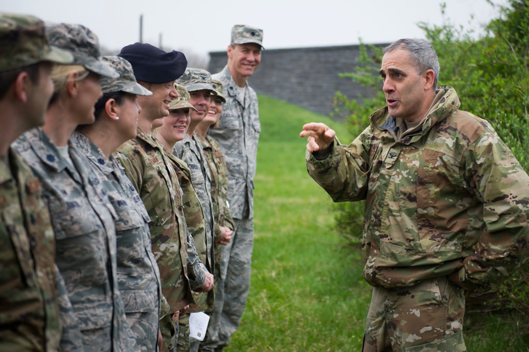 Army Col. Phillip Cuccia, U.S. Army War College academic engagement director, right, discusses Civil War-era battlefield formation tactics with Air Force officers as part of the 2019 Air Force District of Washington Squadron Commander and Spouse Orientation Course at Gettysburg National Military Park, Pa., April 18, 2019. (U.S. Air Force photo by Master Sgt. Michael B. Keller)