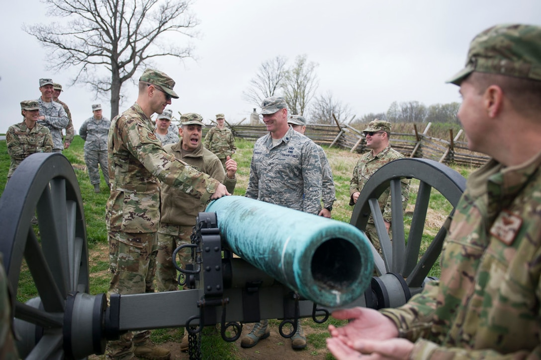 Army Col. Phillip Cuccia, U.S. Army War College academic engagement director, center, goes through the steps of firing a Civil War cannon with U.S. Air Force field grade officers at Gettysburg National Military Park, Pa., April 18, 2019. The Air Force officers took a tour of the park during the 2019 Air Force District of Washington Squadron Commander and Spouse Orientation Course to learn about leadership principles from the past, and how they relate to the present. (U.S. Air Force photo by Master Sgt. Michael B. Keller)