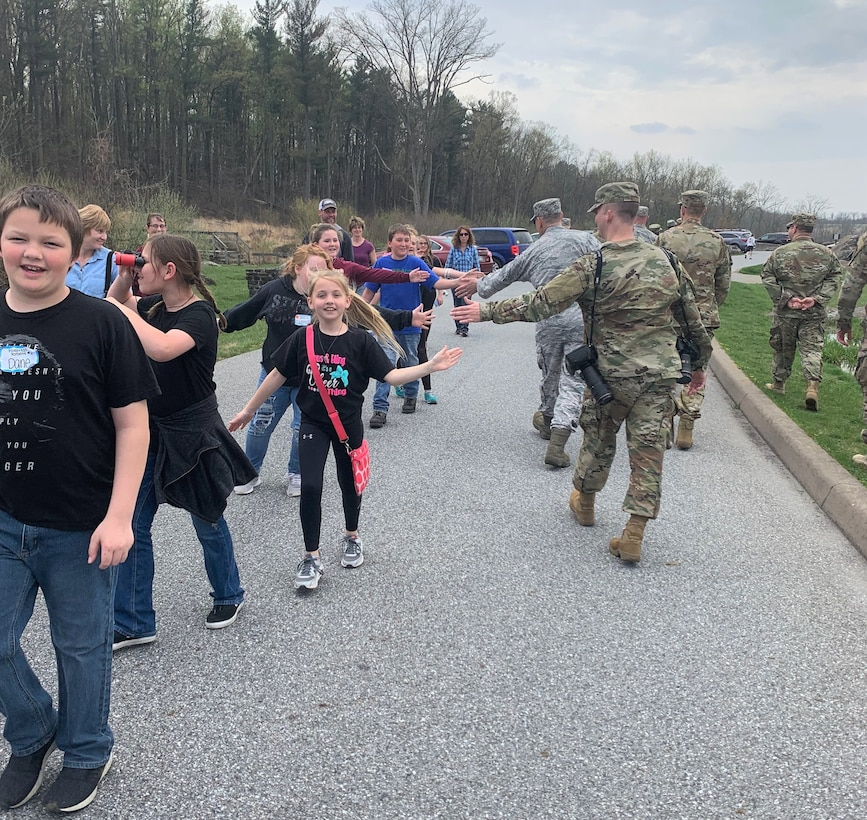 A middle school tour group high-fives Air Force District of Washington Airmen during a tour of the Gettysburg Battlefield in Pennsylvania April 18. The service members were there as part of the 2019 AFDW Commander and Spouse Orientation Course. (U.S. Air Force photo by Master Sgt. Amaani Lyle)