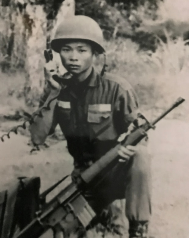 Chien Van Bui, an artilleryman in the South Vietnam army relays artillery rounds during the Vietnam War. His son, Lt. Col. Asan Bui, now serves as a communications flight commander in the U.S. Air Force Reserve's 920th Rescue Wing based at Patrick Air Force Base, Florida. Coincidentally, Bui's current unit can trace its roots back to the Vietnam War. (Courtesy photo)