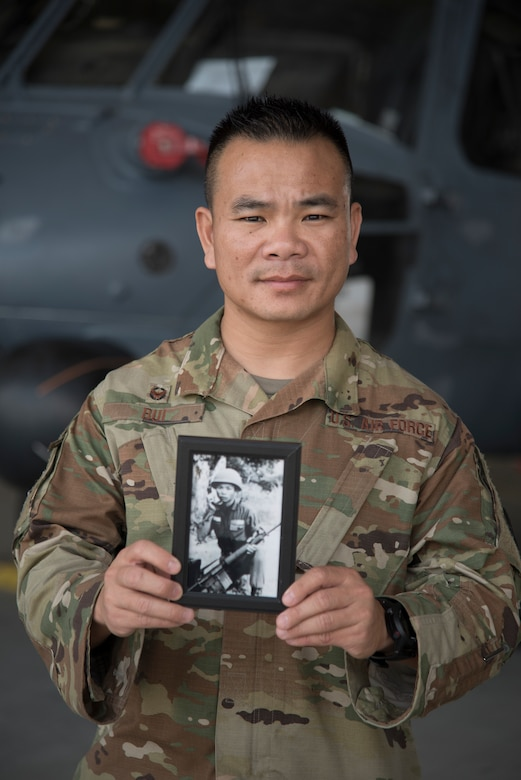 Lt. Col. Asan Bui, 920th Communications Flight commander, holds a photo of his late father, Chien Van Bui, while on duty at Patrick Air Force Base, Florida, on April 6, 2019. Bui said he has a lot of respect for his father who served in the South Vietnamese Army during the Vietnam War. The lieutenant colonel serves with the 920th Rescue Wing, a combat-search-and-rescue unit as part of the Air Force Reserve. (U.S. Air Force photo by Senior Airman Brandon Kalloo Sanes)
