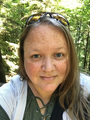 Kim Adkins poses for a selfie while hiking at Capilano Suspension Bridge Park in Vancouver, British Columbia, Canada in 2017.