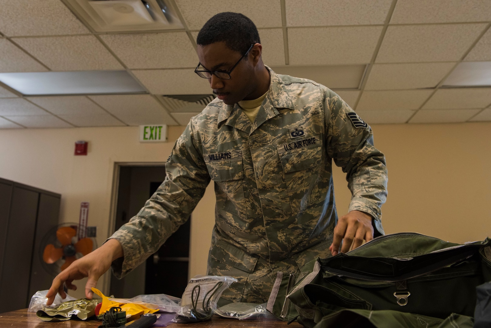 U.S. Air Force Tech. Sgt. John J. Williams, 354th Operations Support Squadron Aircrew Flight Equipment (AFE) flight quality assurance craftsman, packs an F-35A Lightning II survival bag at Eielson Air Force Base, Alaska, April 24, 2019. The AFE Airman's job is to enhance the probability of survival for downed pilots by supplying all aircraft survival equipment such as parachutes, helmets and survival kits. (U.S. Air Force photo by Airman 1st Class Aaron Larue Guerrisky)