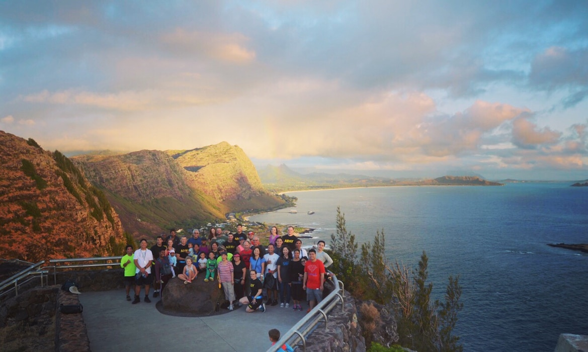 Honolulu District Commander Lt. Col. Kathryn Sanborn, Honolulu District Deputy District Commander Maj. Josh Sturgill and Pacific Ocean Division Command Sgt. Maj. Patrickson Toussaint led roughly 40 Division and District personnel, families and friends on a two-mile hike to view the sunrise from the Corps of Engineers-built Makapu`u Lighthouse April 25, 2019, celebrating the 114th Birthday of the District. The Corps built Makapu'u Lighthouse in 1909 on a 647-foot sea cliff overlooking Makapu'u Beach in southeast Oahu. The Corps' history in Hawaii and the Pacific began in 1905 when Lt. John Slattery became the District's first commander. His original mission was to construct lighthouses for navigation, like Makapu'u. Makapu'u Point is an important location passed by all ships moving between Honolulu and the U.S. Mainland. The lighthouse is still an active U.S. Coast Guard navigation aid in use today.