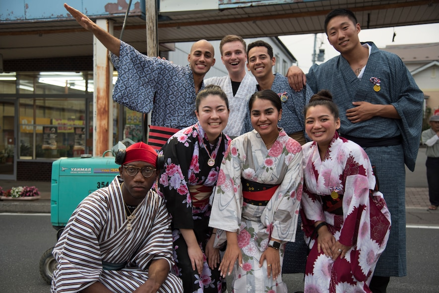 A group of U.S. service members pose in traditional Japanese kimonos during the Tanabata Festival in Misawa City, Japan, July 26, 2019. This wide sleeve loose robe is typically worn as a formal garment for special occasions. Attendees participated in a Yukata fashion contest displaying the garment for judges and audience members to observe and enjoy. (U.S. Air Force photo by Branden Yamada)