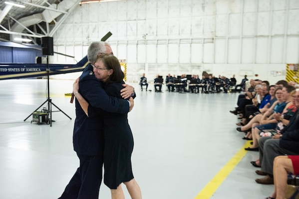 Air Force Gen. Paul J. Selva, vice chairman of the Joint Chiefs of Staff, embraces his wife Ricki during a retirement ceremony hosted by Marine Corps Gen. Joe Dunford, chairman of the Joint Chiefs of Staff, at Hanger 3, Joint Base Andrews, Md., July 31, 2019. Gen. Selva retires after over 39 years of service.