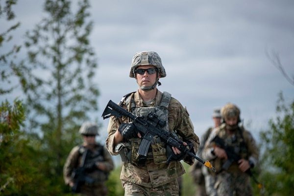 An Airman from the Georgia Air National Guard's 116th Security Forces Squadron acts as the point man for a joint Security Forces and Latvian patrol during Northern Strike 19 while training in Rogers City, Mich., July 31, 2019.