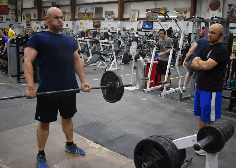 Army Staff Sergeants Robert W. Stephens and Raymond E. Stephens spend time together in the gym while deployed to Camp Arifjan, Kuwait, with the 77th Sustainment Brigade, July 30, 2019.