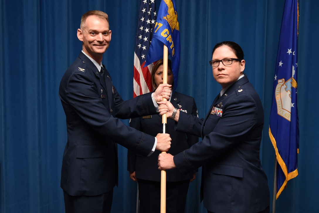 U.S. Air Force Lt. Col. Shay Edwards (right), accepts the guidon and command of the 377th Comptroller Squadron from Col. David Miller, 377th Air Base Wing commander, during a change of command ceremony at Kirtland Air Force Base, N.M., July 31, 2019. Edwards previously served as the U.S. Air Forces in Europe and Africa Budget and Operations Branch Chief. (U.S. Air Force photo by Senior Airman Eli Chevalier)