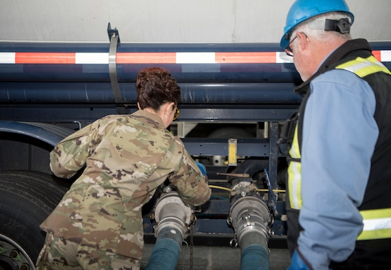 U.S. Air Force Col. Patricia Csànk, 673d Air Base Wing and Joint Base Elmendorf-Richardson commander, pulls a lever at a tank truck offload facility on JBER, Alaska, July 25, 2019. The TTOF became fully operational December 2018, and provides a secondary means to receive JP-8 (Jet Propellant 8) in the event JBER's fuel pipelines are out of service due to maintenance, damage or natural disaster.
