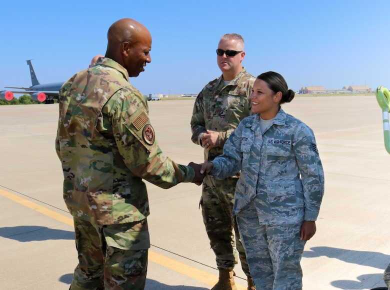 Chief Master Sgt. of the Air Force Kaleth O. Wright coins Staff Sgt. Amber Artis a medical technician for her outstanding performance during his visit to the 507th Air Refueling Wing, Tinker Air Force Base, Oklahoma, July 31, 2019. (U.S. Air Force photo by Senior Airman Mary Begy