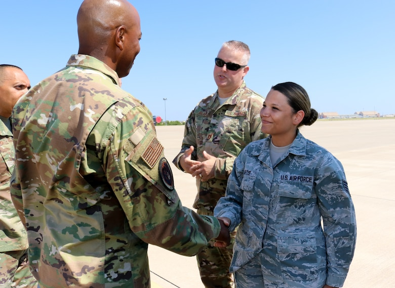 Chief Master Sgt. of the Air Force Kaleth O. Wright coins Staff Sgt. Amber Artis a medical technician for her outstanding performance during his visit to the 507th Air Refueling Wing, Tinker Air Force Base, Oklahoma, July 31, 2019. (U.S. Air Force photo by Senior Airman Mary Begy)