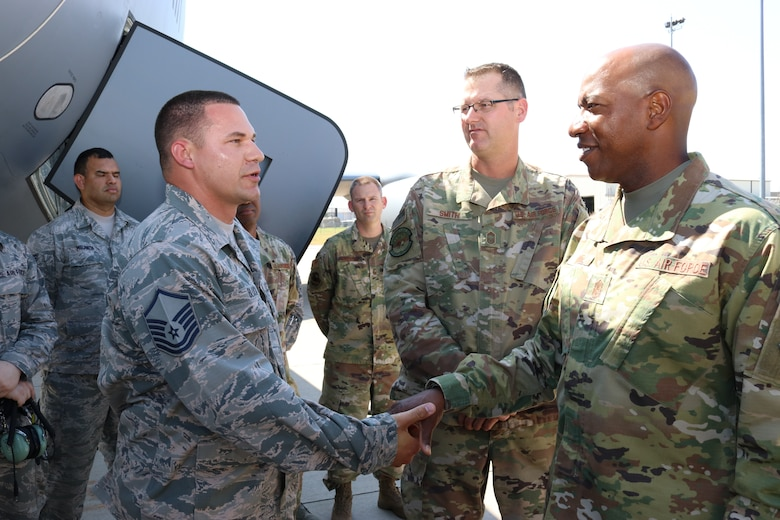 Chief Master Sgt. of the Air Force Kaleth O. Wright coins Master Sgt. Brad Block, an aircraft maintenance supervisor, for his outstanding performance during his visit to the 507th Air Refueling Wing, Tinker Air Force Base, Oklahoma, July 31, 2019. (U.S. Air Force photo by Senior Airman Mary Begy)