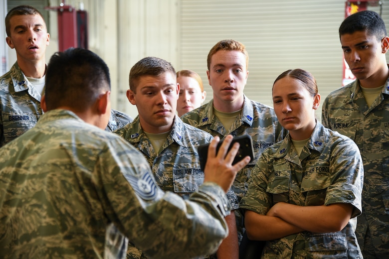 Air Force ROTC cadets watch a safety video during a tour of Hill Air Force Base, Utah, July 24, 2019. Over 80 cadets visited Hill as part of a professional development training program called Operation Air Force. The program gives cadets a greater understanding of the Air Force while introducing them to a variety of careers fields. (U.S. Air Force photo by R. Nial Bradshaw)