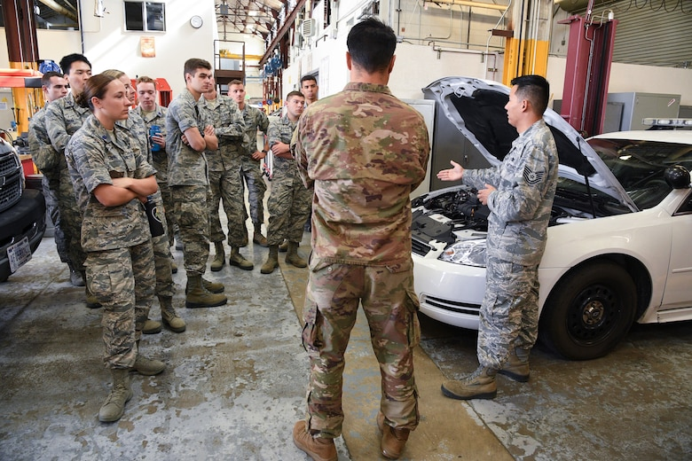 Tech. Sgt. Benjamin Erwin, 75th Logistics Readiness Squadron vehicle maintenance, speaks to Air Force ROTC cadets during a tour of Hill Air Force Base, Utah, July 24, 2019. Over 80 cadets visited Hill as part of a professional development training program called Operation Air Force. The program gives cadets a greater understanding of the Air Force while introducing them to a variety of careers fields. (U.S. Air Force photo by R. Nial Bradshaw)