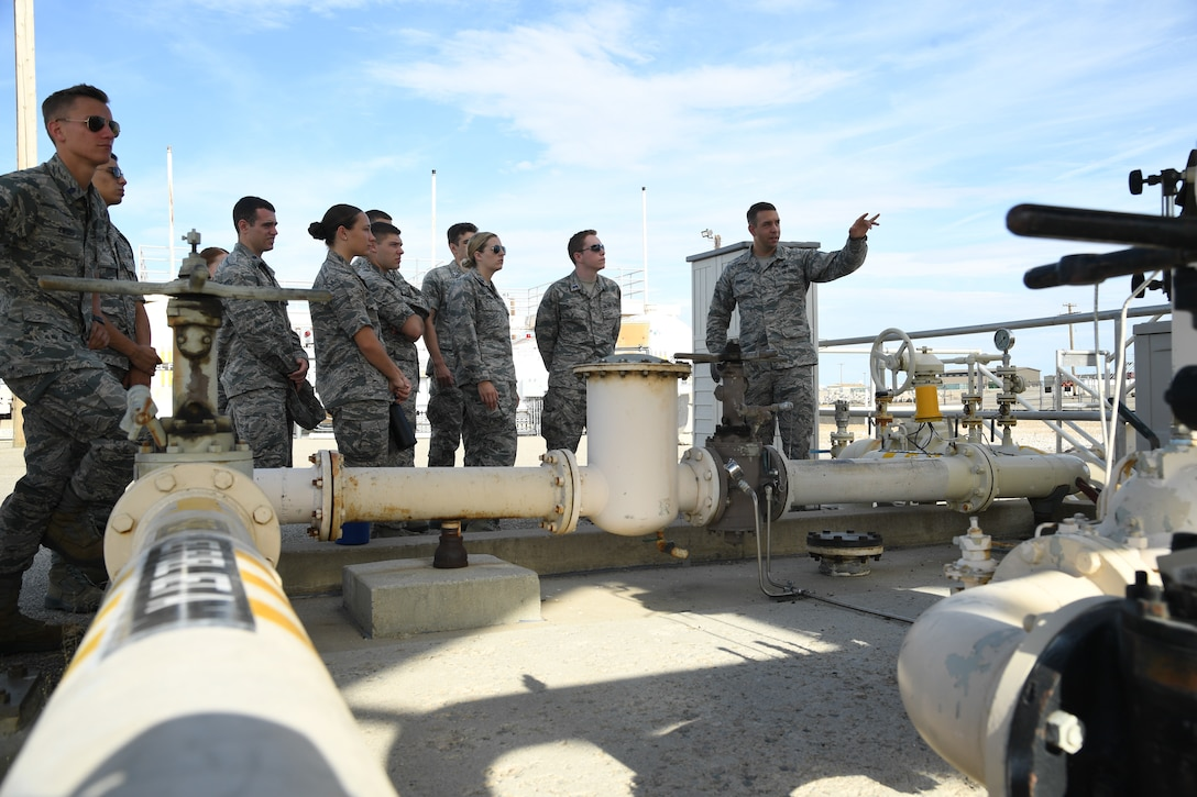 Staff Sgt. James Egger, 75th Logistics Readiness Squadron fuels technician, speaks to Air Force ROTC cadets during a tour of Hill Air Force Base, Utah, July 24, 2019. Over 80 cadets visited Hill as part of a professional development training program called Operation Air Force. The program gives cadets a greater understanding of the Air Force while introducing them to a variety of careers fields. (U.S. Air Force photo by R. Nial Bradshaw)