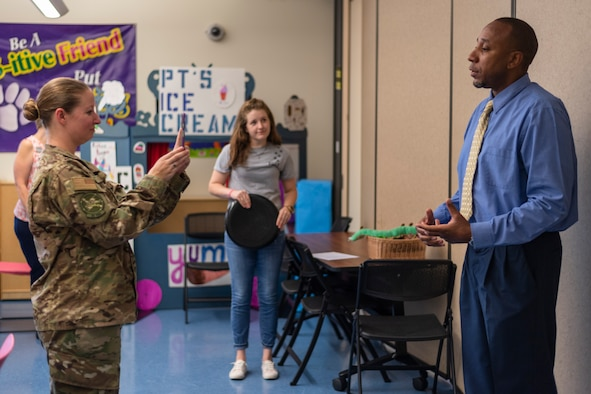 Darren Hill, right, 23d Force Support Squadron school liaison, addresses parents while being recorded, at Moody Air Force Base, Ga. A school liaison officer serves as the conduit between local schools, military families and the community to help meet the unique needs of military connected students. (U.S. Air Force photo by Airman 1st Class Taryn Butler)