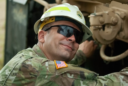 Soldiers dig deep for wheeled vehicle mechanic training