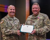 Legion of Merit presented to Lt. Col. Michael Hough.