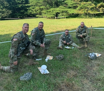 Leaders of the 642nd Aviation Support Battalion and the 42nd Combat Aviation Brigade sample food prepared by the 642nd cooks as part of the Phillip A. Connelly Award Program on July 27, 2019 at Fort Indiantown Gap, Pennsylvania.