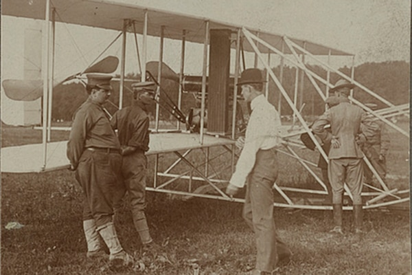 The Wright brothers and some Army Signal Corps soldiers work on the Wright Military Flyer as they test it out at Fort Myer, Virginia, 1909.