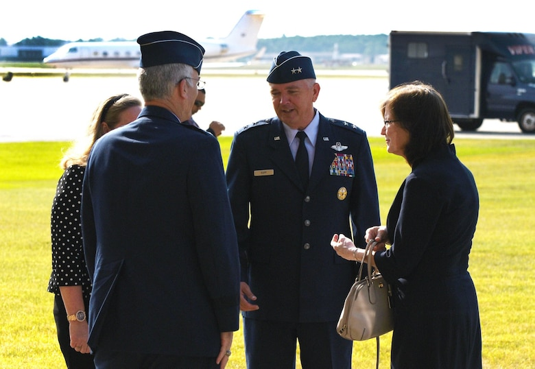 Air Force District of Washington Commander Maj. Gen. Ricky N. Rupp, center, and his wife, Charlotte, left, greet Vice Chairman of the Joint Chiefs of Staff United States Air Force Gen. Paul J. Selva and his wife, Ricki. Selva, who held his retirement ceremony July 31 at Joint Base Andrews Hangar 3, is the 10th Vice Chairman of The Joint Staff. He retires from the Air Force after more than 39 years of honorable service. (U.S. Air Force photo/James E. Lotz)