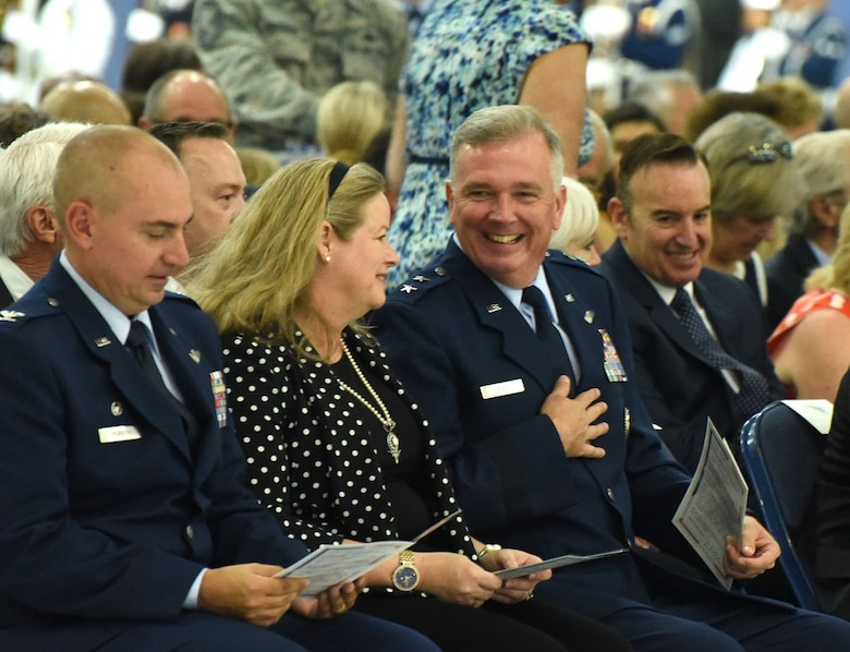 Col. Andrew M. Purath, 11th Wing and Joint Base Andrews commander, peruses a program as Charlotte Rupp and her husband, Air Force District of Washington Commander Maj. Gen. Ricky N. Rupp share a candid moment before the retirement ceremony in honor of United States Air Force Gen. Paul J. Selva, Vice Chairman of the Joint Chiefs of Staff. Selva, the 10th Vice Chairman of The Joint Staff, retires from the Air Force after more than 39 years of honorable service. (U.S. Air Force photo/Master Sgt. Amaani Lyle) — at Joint Base Andrews.