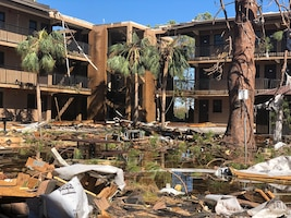 The courtyard of a student housing complex at Tyndall Air Force Base, Florida, sits flooded with water and debris following Hurricane Michael on October 10, 2018. AFIMSC employed a cash-flow strategy for recovery efforts at Tyndall, and in response to March 2019 flooding at Offutt AFB, Nebraska, and following an earthquake at Joint Base Elmendorf-Richardson, Alaska, in November 2018. (U.S. Army photo by Staff Sgt. Alexander Henninger)