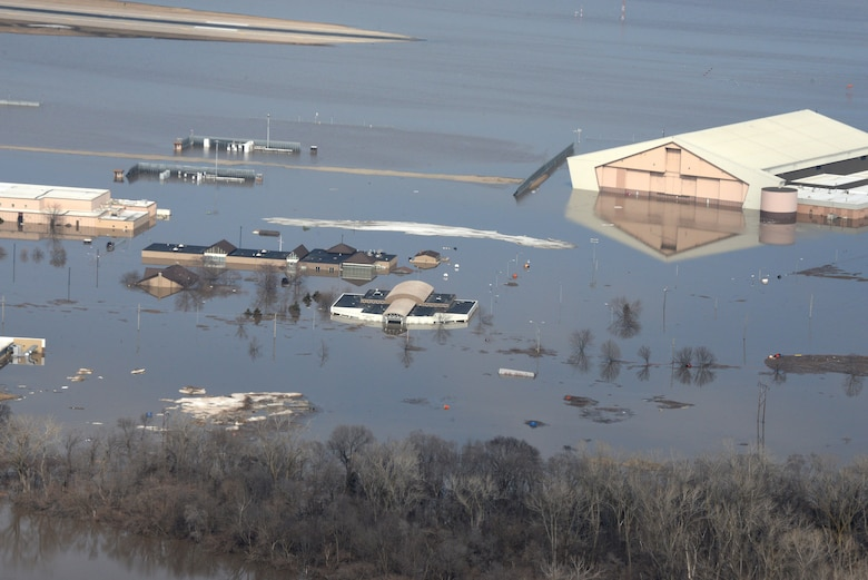 Water covers one-third of Offutt Air Force Base, Nebraska, after the Missouri River flooded in March 2019. AFIMSC cash flowed recovery efforts at Offutt, the October 2018 hurricane at Tyndall AFB, Florida, and the November 2018 earthquake at Joint Base Elmendorf-Richardson, Alaska, in addition to providing funding for border protection at Davis-Monthan AFB, Arizona. (U.S. Air Force photo by Tech. Sgt. Rachelle Blake)