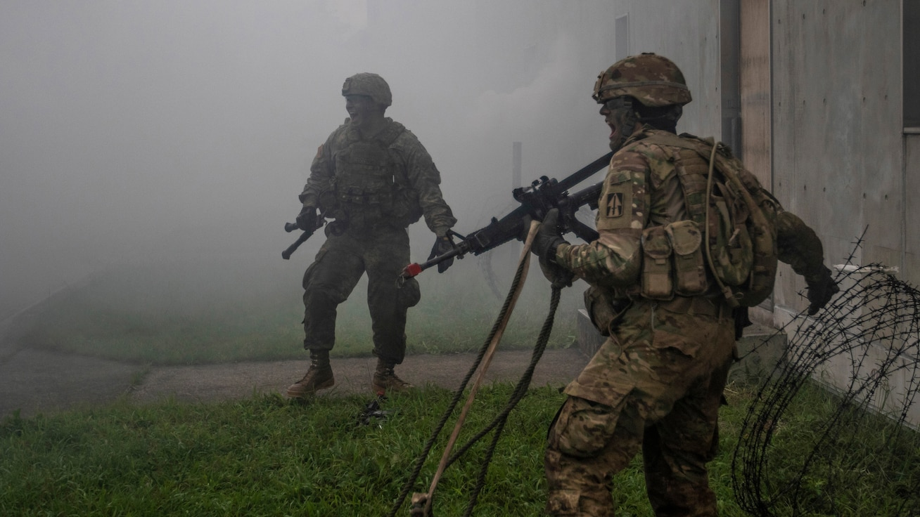 Soldiers of the Indiana National Guard's 76th Infantry Brigade Combat Team yell out to others that they have cleared the route during a training assault for Orient Shield 2018. Orient Shield is an annual, bilateral, tactical field training exercise cohosted by the Japan Ground Self - Defense Force and U.S. Army Pacific Command. This marks the 33rd iteration of this exercise designed to enhance U.S. and Japan's combat readiness and interoperability at the tactical level while strengthening bilateral relationships and demonstrating U.S. resolve to support the security interests of friends and allies in the region. (U.S. Army Photo by Public Affairs Broadcast Journalist Spc. Joshua A. Syberg / Released)
