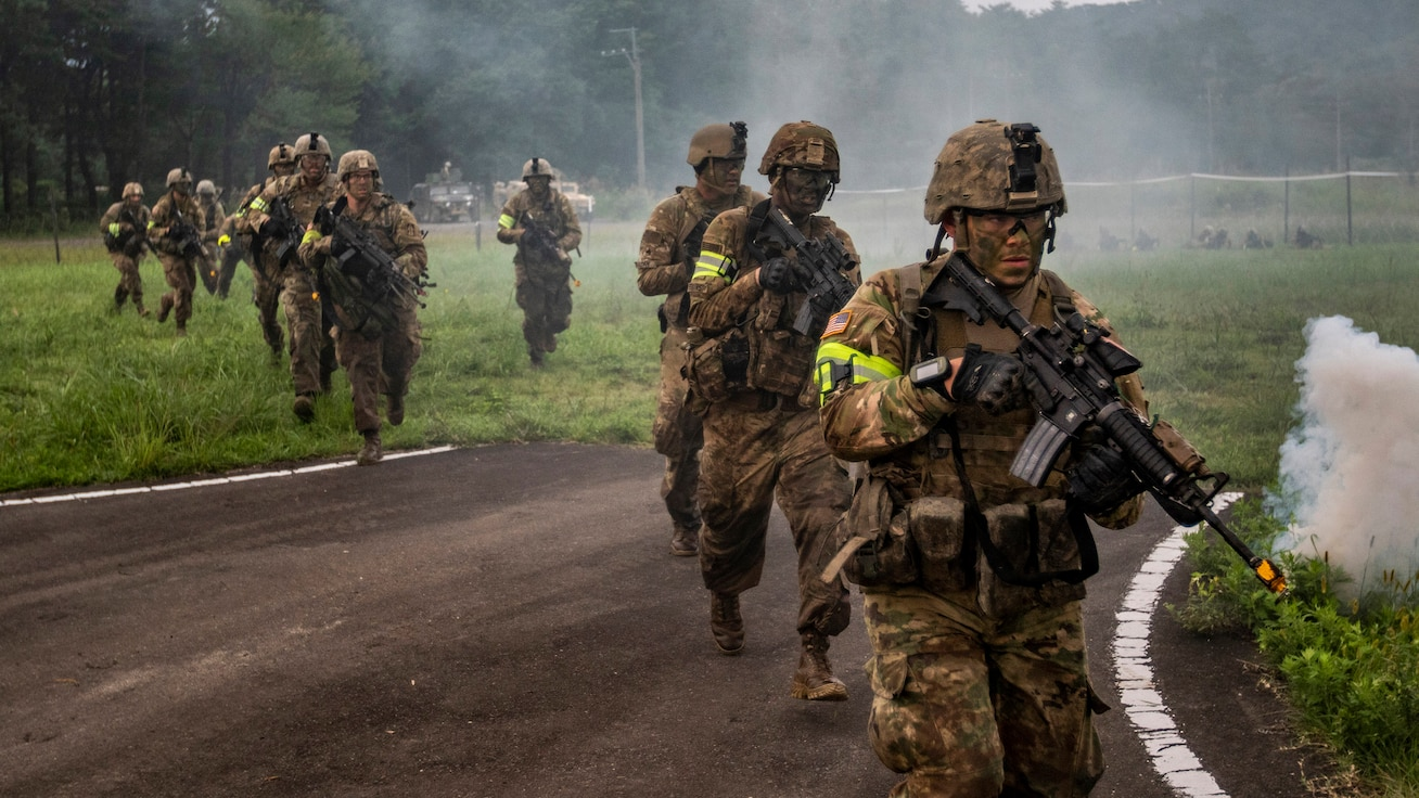Soldiers of the Indiana National Guard's 76th Infantry Brigade Combat Team charge into the fight during a training assault for Orient Shield 2018. Orient Shield is an annual, bilateral, tactical field training exercise cohosted by the Japan Ground Self - Defense Force and U.S. Army Pacific Command. This marks the 33rd iteration of this exercise designed to enhance U.S. and Japan's combat readiness and interoperability at the tactical level while strengthening bilateral relationships and demonstrating U.S. resolve to support the security interests of friends and allies in the region. (U.S. Army Photo by Public Affairs Broadcast Journalist Spc. Joshua A. Syberg / Released)