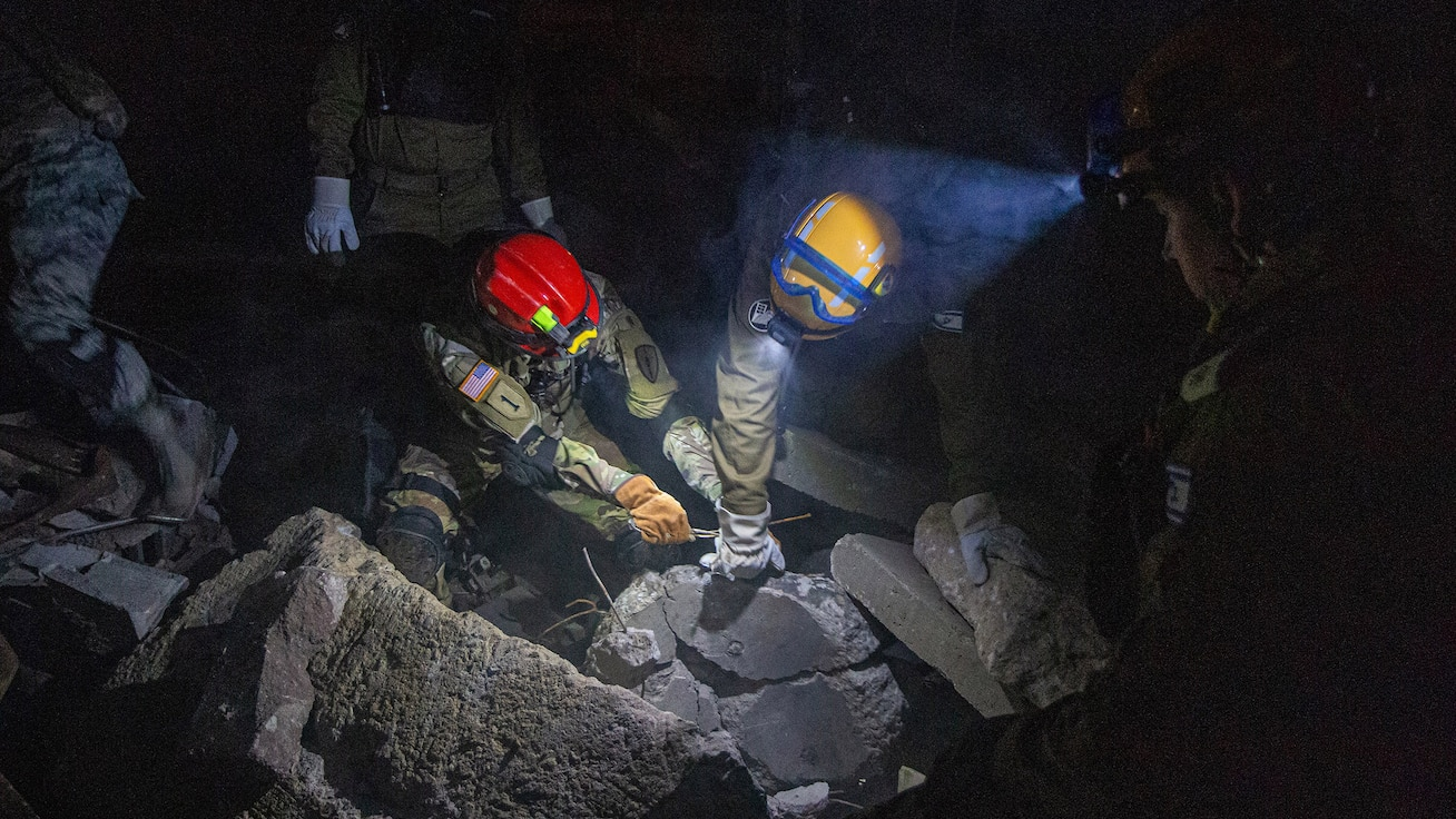 INDIANAPOLIS, Ind. - a mixture of Indiana National Guard Soldiers, Airmen, and IDF Homefront Command National Rescue Unit soldiers, pull rubble in order to retrieve a simulated casualty during United Front VIII at Camp Muscatatuck Urban Training Center June 2, 2019.