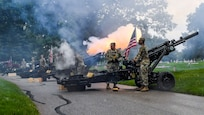 Soldiers with 2nd Battalion, 150th Field Artillery, Indiana Army National Guard, render a 21-gun salute with M-102 105 mm howitzers during a Memorial Day ceremony held at Crown Hill cemetery in Indianapolis May 26, 2019.