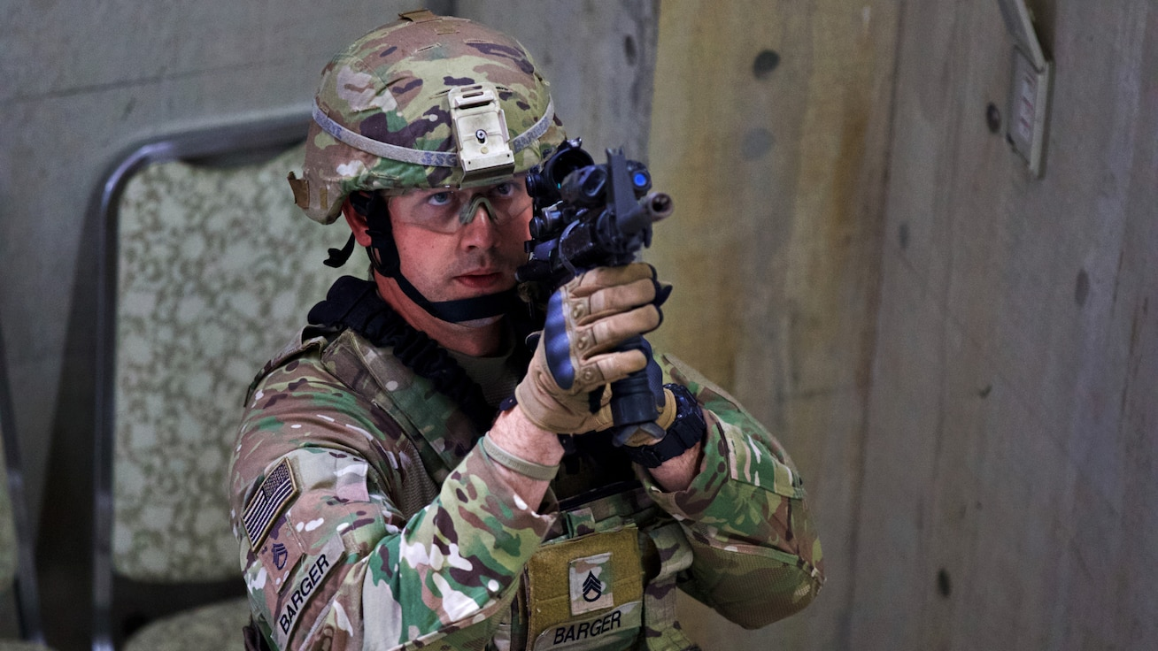 Staff Sergeant Barger of 2-151 Infantry Regiment practices clearing a building during Orient Shield 2018. Since its inception in 1985, Orient Shield has focused on the development and refinement of the Japan Ground Self Defense Force and U.S. Army's efforts in the areas of bilateral planning, coordination and interoperability. This exercise underscores a continued commitment by the United States and Japan to work as dedicated partners in support of the Japan-U.S. security alliance and for peace and stability in the Indo-Pacific region. (U.S. Army Photo by Public Affairs Broadcast Journalist Spc. Joshua A. Syberg / Released)