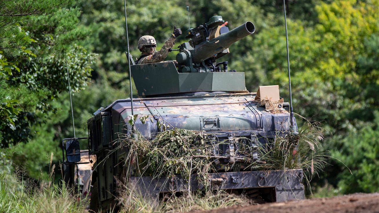 A soldier of the Indiana National Guard's 76th Infantry Brigade Combat Team signals they are good to go before a training assault for Orient Shield 2018. Orient Shield is an annual, bilateral, tactical field training exercise cohosted by the Japan Ground Self - Defense Force and U.S. Army Pacific Command. This marks the 33rd iteration of this exercise designed to enhance U.S. and Japan's combat readiness and interoperability at the tactical level while strengthening bilateral relationships and demonstrating U.S. resolve to support the security interests of friends and allies in the region. (U.S. Army Photo by Public Affairs Broadcast Journalist Spc. Joshua A. Syberg / Released)